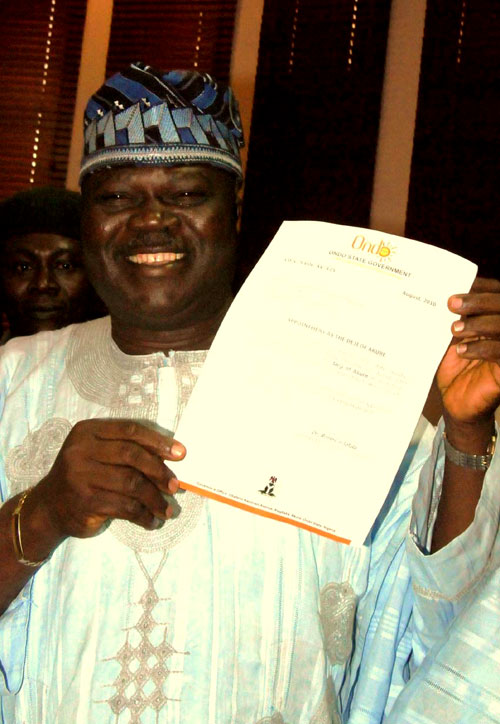 The new Deji of Akure, Adebiyi Adesida displaying his Letter of Appointment shortly after being presented with the letter by the Ondo State Deputy Governor, Alhaji Ali Olanusi at the Governor's Office in Akure on Thursday.