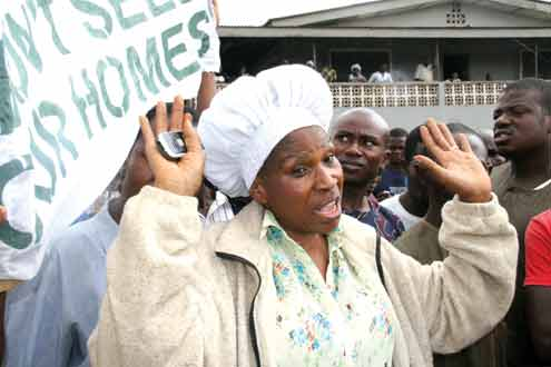 •Mrs. Adefowora, one of the landladies and others protesting this morning over the demolition of their houses in Awori area of Abule-Egba, Lagos. PHOTO:OLATUNJI OBASA.