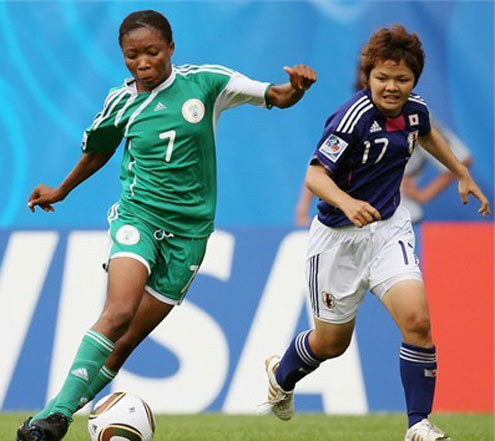 Falconets' Esther Sunday (left) tries to beat a Japanese player.