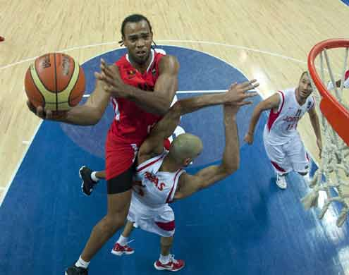 Gomes Soaquim of Angola (left) goes for a lay-up during yesterday's FIBA-Africa World Championship match against Jordan. Angola won 79-66 points.