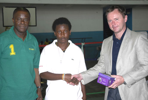 L-R Kate Peters, receives her overall best boxer award at the last weekend's Saturday Night Monthly Boxing Show from Richard Gill, Marketing Director, Starcomms Plc, while Wale Edun, Chairman of the Lagos Boxing Hall of Fame looks on at the Starcomms sponsored competition which holds at Rowe Park, Yaba, Lagos, Nigeria.
