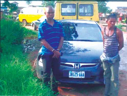 The robbery suspects after their arrest following the discovery of the car where it was parked.