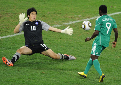 Nigeria's striker Obafemi Martins (right) shoots at goal as South Korea's goalkeeper Jung Sung-Ryong attempts a save during their Group B first round 2010 World Cup football match on 22 June, 2010 at Moses Mabhida stadium in Durban. Madagascar keeper, Kassima says Martins is a dangerous player after Sunday's 2012 Nations Cup qualifier in Calabar. PHOTO: AFP.