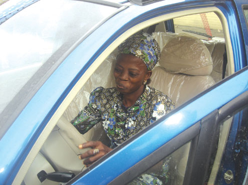 Mrs. Modupe Ajoke Fagbolu, demostrating with her brand new car.