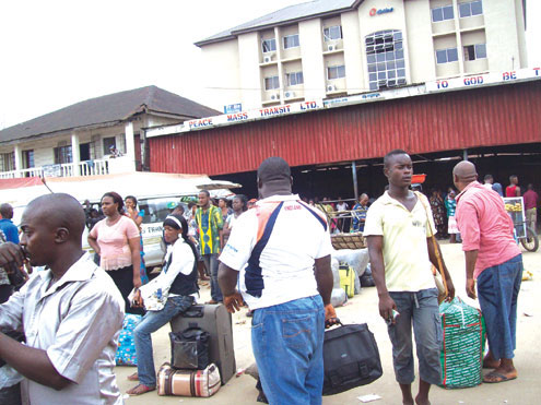 Aba residents fleeing the city which is under siege by armed robbers and kidnappers. PHOTO: JUDE ORJI.