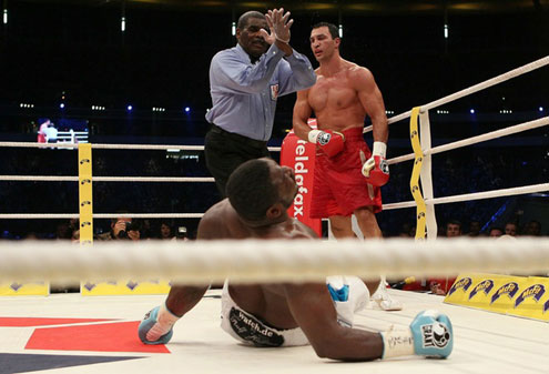OOPS…Samuel Peter of Nigeria kisses the canvas after being knocked down by Wladimir Klitschko of Ukraine during the WBO and IBF World Championship Heavyweight fight on September 11, 2010 at the Commerzbank Arena in Frankfurt, Germany.
