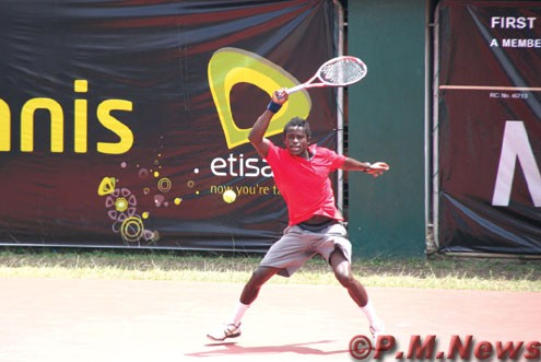 RETURN… Clifford Enosoregbe of Nigeria returns a serve during yesterday's Gov's Cup Future 2 match against top seed Amir Wentraub of Israel. Amir, who won the Futures 1 trophy, lost yesterday's match 2-6, 6-7 to Clifford. Inset is Amir. Photo: Akin Farinto.