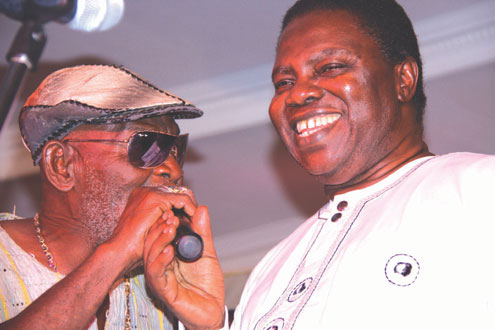 Fatai Rolling Dollar and Ebenzer Obey in a duet at the concert.
