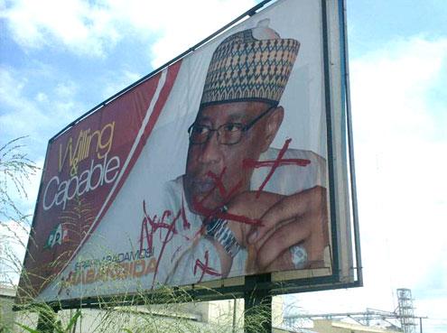 Defaced IBB's campaign billboard in Ibadan, Oyo State, South West Nigeria. PHOTO: Gbenro Adesina