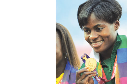 Osayemi displaying the gold medal she won at the tournament.