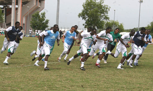 RACE AGAINST TIME… A file photo the Super Eagles show the team in training before a match. The Eagles, yesterday continued with their training in Abuja despite the ban on Nigerian football by FIFA. Photo: Femi Ipaye.