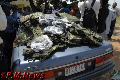 The undetonated wired car and recovered military wares.