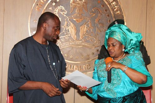 Dame Patience Jonathan, Nigeria's First Lady presenting a condolence letter to Rt. Hon. Chibuike Rotimi Amaechi, Governor of Rivers State during her condolence visit to Rivers State.