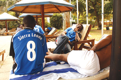 RELAXATION…Players of Sierra Leone relax at the pool side of Eko Hotels yesterday. They will play against the Super Eagles tomorrow. Photos: Emmanuel Osodi