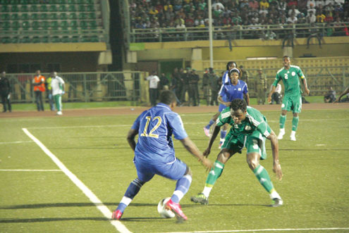 •MIND GAME…Super Eagles of Nigeria's defender, Taye Taiwo (r) thinks of how to stop Obi Metzeger of Leone Stars during a friendly match at Teslim Balogun Stadium in Lagos, Nigeria yesterday. Eagles won 2-1. Photo: Emmanuel Osodi.