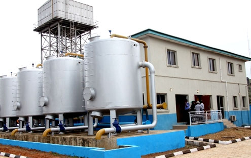 The Ikorodu Mini Water Works Commissioned by the Governor  Babatunde Fashola last week. Inset: Fashola (middle), cutting the ribbon to commission the Mini Water Works. With him are: Action Congress of Nigeria (ACN) Senatorial Candidate for Lagos East, Alhaji Gbenga Ashafa (left), General Manager, Lagos State Water Corporation (LSWC), Mrs. Dele Fatusi (2nd left), House of Representatives member, Hon Abike Dabiri-Erewa and Lagos State House of Assembly member, Hon Sinai Agunbiade (right).