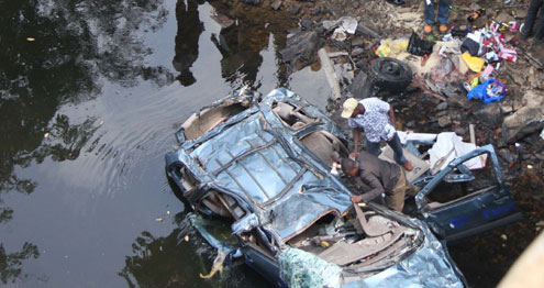 The wrecked car inside the river.