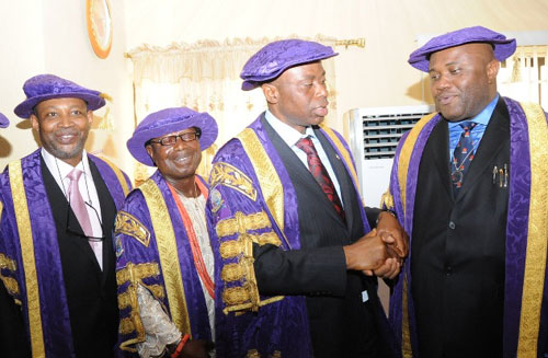 (L-R) The Vice Chancellor, the Adekunle Ajasin University Akungba Akoko(AAUA), Prof Femi Mimiko, Chancellor, Oba Gbadebo Bajowa, the Rebuja of Osooro, Ondo State Governor and Visitor, Dr Olusegun Mimiko  and  Acting Pro-Chancellor and Chairman, Governing Council of the Institution, Chief Dan Nwayawu during the 3rd Convocation Ceremony of the institution at the weekend