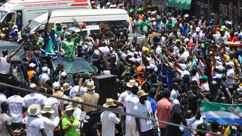 Lagos State Governor, Mr. Babatunde Fashola (SAN) and his running mate, Hon  (Mrs) Adejoke Orelope-Adefulire acknowledging cheers from party supporters during the campaign of the party at Apapa Local Government Council Area, Lagos on Saturday, March 26, 2011.