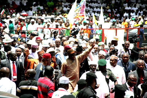 PRESIDENT GOODLUCK JONATHAN ACKNOWLEDGING CHEERS FROM PDP SUPPORTERS AT THE RALLY.
