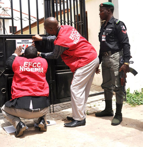 EFCC Operatives sealing one of the Igbinedion properties located at Asokoro, Abuja.