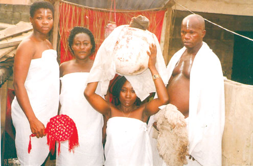 The fake herbalist performing rituals on the ladies.