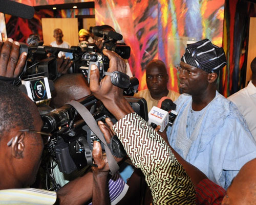 """Lagos State Governor, Mr. Babatunde Fashola SAN (right) fielding questions from Journalists after the 6th Executive/Legislative Parley on: """"Good Governance and Strategic Planning"""" organized by the Political and Legislative Powers Bureau, Governor's office, at Golden Tulip, Festac, Lagos on Friday, March 4, 2011."""