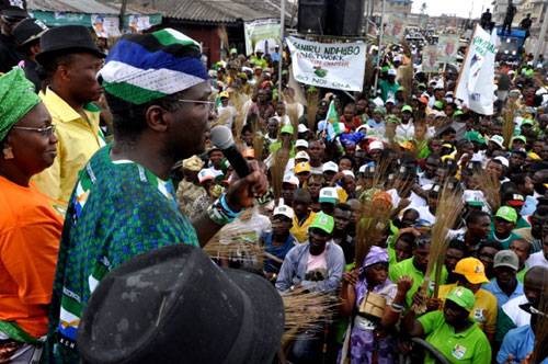 Lagos State Governor, Mr. Babatunde Fashola (SAN),(3rd  left) addressing supporters during the Action Congress of Nigeria (ACN) campaign rally at Ajeromi Ifelodun Local Government, Lagos on Friday, March 25, 2011. With him  are:  the First Lady, Lagos State, Dame Emmnuella Abimbola  Fashola (2nd left) and Managing Director, LASAA, Mr. Tunji Bello(left).
