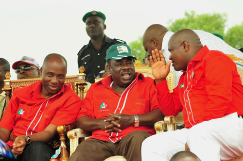 Governor Amaechi, Chief Godpower Ake, PDP Chairman, Rivers State, and Chief Nyesom Wike, D-G, Amaechi Campaign Organisation, exchanging pleasantries during the 2011 Governorship campaign rally at Obio/Akpor LGA in Rivers State.