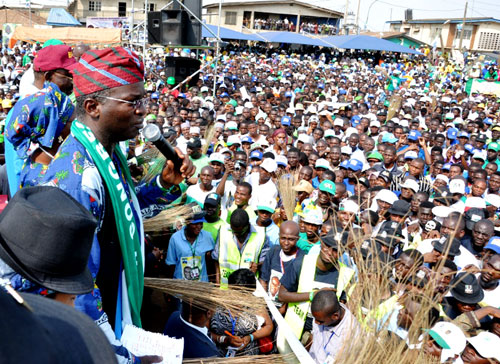 Lagos State Governor Mr. Babatunde Fashola SAN (left), addressing Party supporters during the Action Congress of Nigeria (CAN) Mega Rally at Agege, Lagos on Tuesday, March 22, 2011.