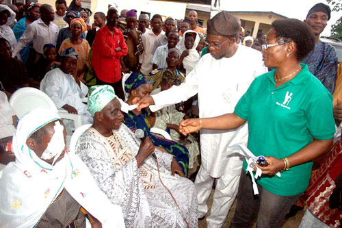 Osun State Governor, Ogbeni Rauf Aregbesola removing the surgical gauze and bandage from the operated eye of one of the beneficiaries. With him are the leader of the medical Team, Dr (Mrs) Jumoke Ibidapo, Secretary to the State Government, Alhaji Moshood Adeoti (behind the Governor) and others, at the closing ceremony of the Free Eye Treatment scheme in Osun State, held at the State Hospital, Ede, Osun State on Friday 25-03-2011