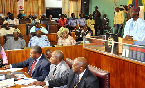 Lagos State Governor, Mr. Babatunde Fashola SAN (right), addressing the members-elect of the Lagos House of Assembly during the Proclamation & Inauguration of the Seventh Legislative  Assembly at the Assembly Chamber, Lagos State House of Assembly Complex, Alausa, on Saturday, June 4, 2011.
