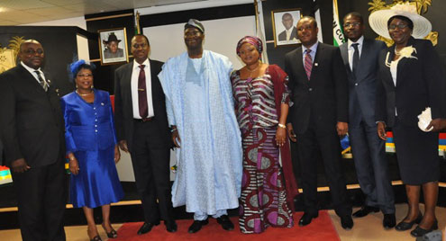 Lagos State Governor, Mr. Babatunde Fashola SAN (4th left), his Deputy, Mrs. Victoria Orelope Adefulire (4th right), the Head of Service, Mr. Adesegun Ogunlewe (3rd left) in a group  photograph with the newly appointed Permanent Secretaries in the State Public Service during the swearing-in ceremony at Lagos House Ikeja, on Thursday, June 9, 2011.
