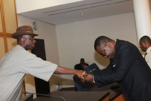 Rivers State Governor, Rt. Hon. Chibuike Rotimi Amaechi (left) congratulating Dr Chamberlain Peterside, shortly after been sworn-in as Commissioner in Government House, Port Harcourt.