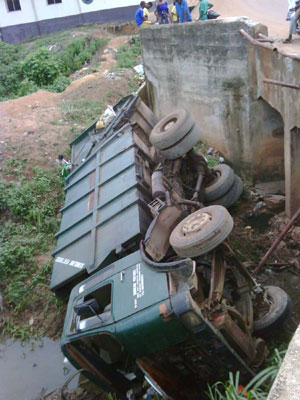 The truck driven by the late driver in the canal