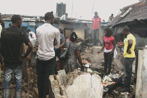 Scene of fire incident caused by playing kids at Olalubi Street, Mafoluku, Lagos, yesterday. PHOTO: KOLA ALIYU.