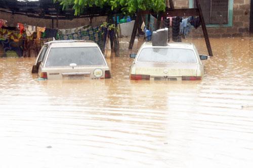 A flooded compound along the Lagos-Abeokuta Expressway.