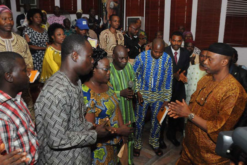 Ondo State Governor, Dr Olusegun Mimiko  (R ) addressing appreciative labour Union Leaders in Akure at the weekend shortly after approving the payment of the N18,000 Minimum Wage Salary at the Governor's Office at the weekend.