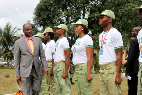 Gov.Chibuike Amaechi inspecting the Guard of Honour at the Swearing-in-ceremony of 2011 Batch 'B' Orientation exercise at NYSC Camp,Nonwa-Gbam,Tai LGA.