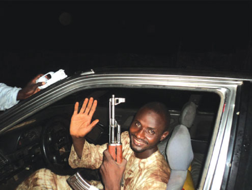 JOURNEY OF NO RETURN: Mohammed Manga on his way to Abuja where he detonated a bomb at the Police Headquarters car park on Thursday, 16 June, 2011. PHOTO: Blueprint newspaper.