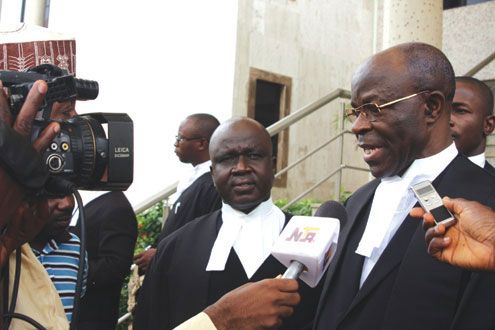 •R-L- Chief Akin Olujimi(SAN) and Rickey Tarfa(SAN) counsel to Justice Ayo Salami, at the Abuja High Court this morning. PHOTO: FEMI IPAYE.