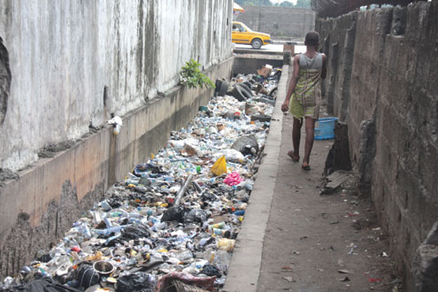 DIRTY LAGOSIANS…Refuse takes over a drainage channel at Jibowu, Yaba.