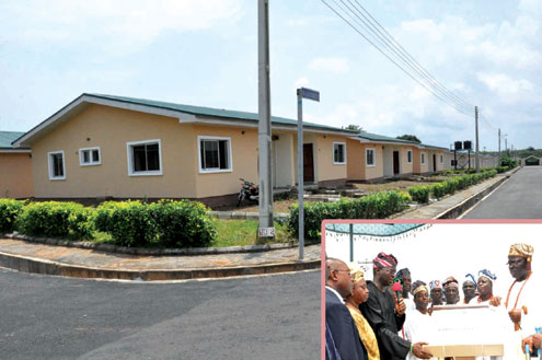 Side view of the newly commissioned estate, and (inset) Governor. Babatunde Fashola SAN (3rd left) unveiling the plaque to commission the Housing Estate in Epe. With him are: Former First Lady of Lagos State, Mrs. Doja Otedola (2nd left), Commissioner of Housing, Mr. Bosun Jeje (left),  Aladeshoyin  of Noforija Kingdom, Oba Babatunde Ogunlaja  and other traditional rulers.