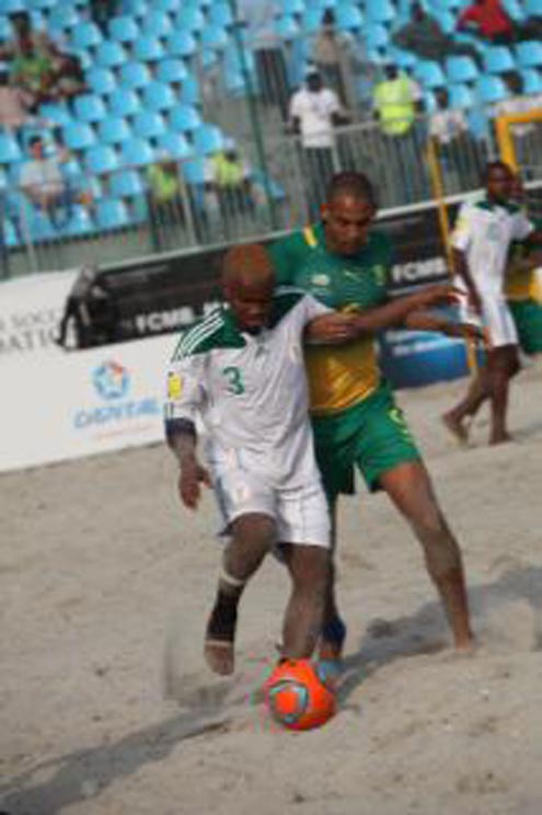 Ogbonnaya Okemiri (front) of Nigeria is tackle from  behind by Ryle Penn of South Africa, during their Copa Lagos Beach Soccer opening match at Eko Atlantic Beach, Victoria Island,  Lagos. Nigeria won by 7-3. Photo… courtesy DSTV