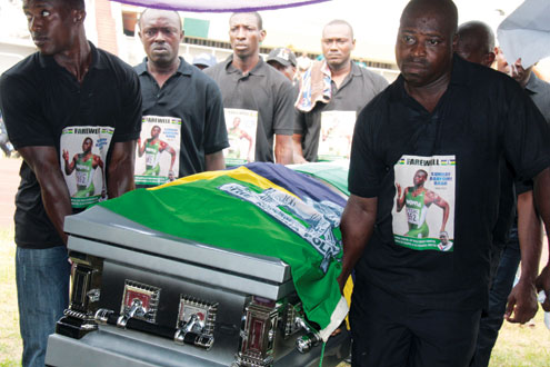 The remains of Nigeria's late sport star, Sunday Bada, being taken to the main bowl of the National Stadium, Surulere, Lagos, for the lying in state today. PHOTOS: IDOWU OGUNLEYE.