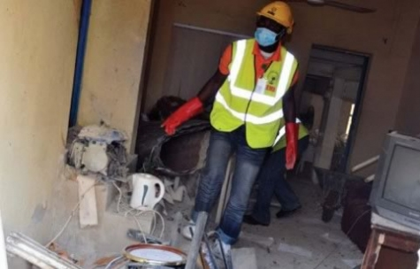 Anti-bomb squads clean up a Boko haram bomb factory shortly after it exploded