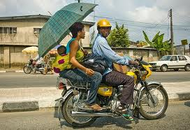 okada rider with mother and child