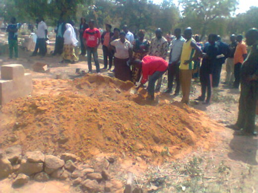 Relatives burying one of the dead victims at Ahmadiyya Burial Ground Tuesday afternoon