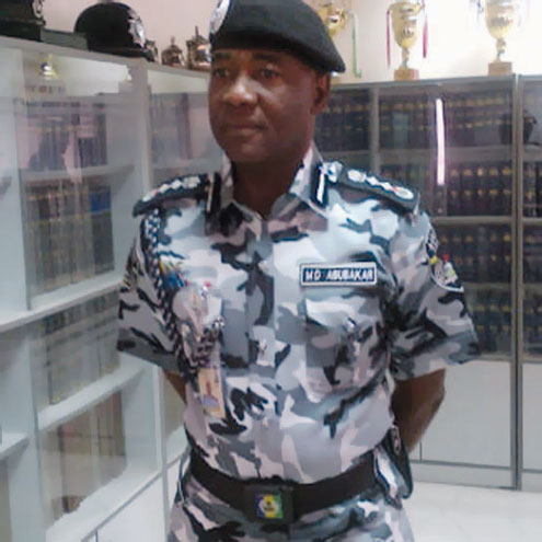 Inspector General, Muhammed Abubakar steps out in the new police uniform.