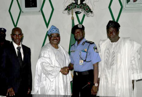 Oyo State Governor Abiola Ajimobi receiving the Inspector General of Police, Mohammed Abubakar in his office Thursday. To their right are Deputy Governor, Moses Alake and left the Secretary to the State Government, Alhaji Waheed Akin Olajide.